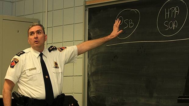 Police Chief Glenn De Caire explained how collective bargaining is done at a public meeting about the Hamilton Police Service budget on Thursday night. De Caire's newest budget request is a 3.9 per cent increase, down from a 4.25 per cent proposal.