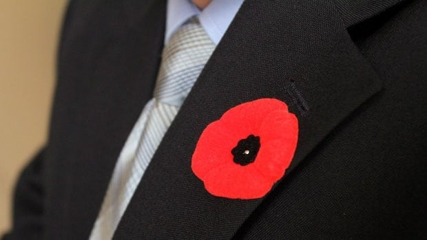 A man wears a poppy from the Canadian Legion. Proceeds from the poppy fundraiser go towards helping veterans.