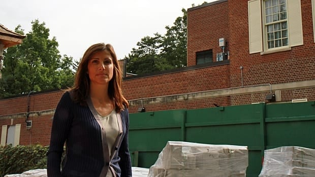 Lisa Guglietti was surprised to see eight cellular antennas installed on the building next door to her house.