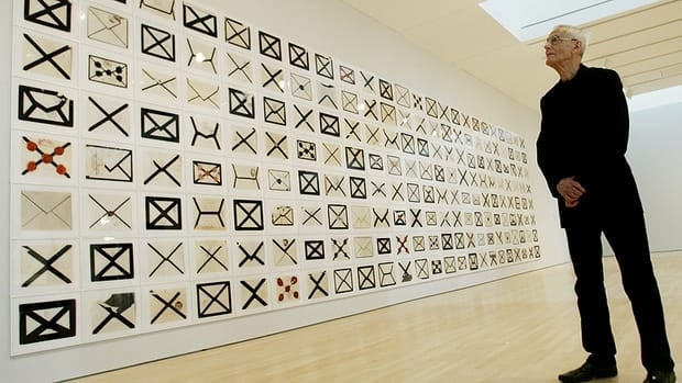 Artist Arnaud Maggs poses with his work of art titled Notification xiii at the National Gallery in Ottawa on March 22, 2006. He died Saturday.