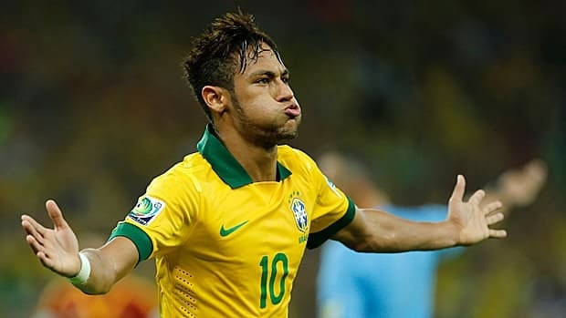 Brazil's Neymar celebrates scoring his remarkable goal during the soccer Confederations Cup final against Spain at the Maracana stadium in Rio de Janeiro on Sunday.