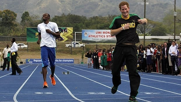 Prince Harry and Olympic gold medallist Usain Bolt run a race at the Usain Bolt track at the University of the West Indies in Kingston, Jamaica.