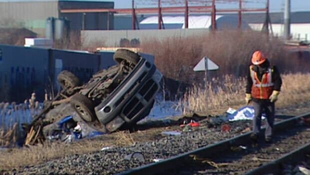 A man died when his truck collided with a train at a crossing in south Edmonton on Monday.