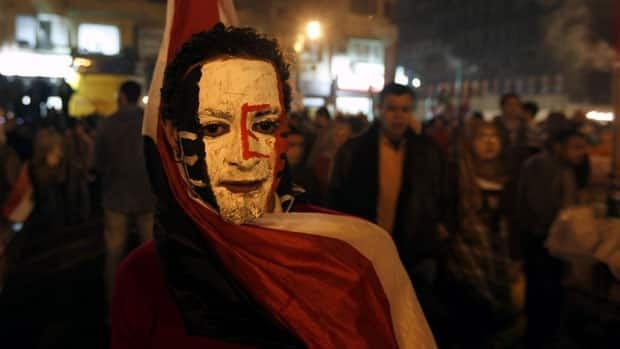 An Egyptian protester with the colours of the national flag on his face joins fellow protesters at Cairo's Tahrir Square on Tuesday in preparation to mark the first anniversary of the revolution Wednesday.