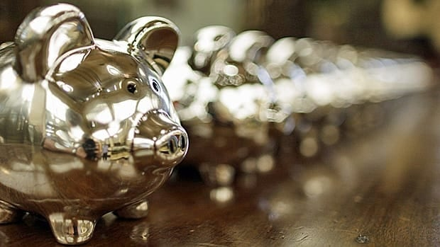 A line of piggy banks are shown. Canadians are not putting enough money into their own savings plans, a survey suggested Thursday.