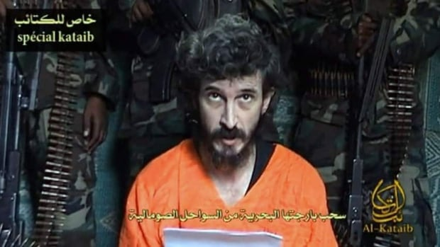 An undated file image from a video posted on Islamic militant websites shows a man identified as French security agent Denis Allex pleading for his release from the Somali militant group al-Shabaab. The militants said Thursday they have executed the French commando.
