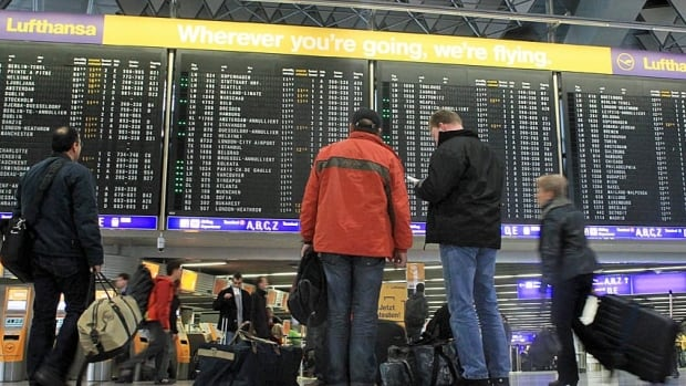 Passengers look at a flight departure information board at the main terminal of Frankfurt's airport. The industry is set for huge losses this year.