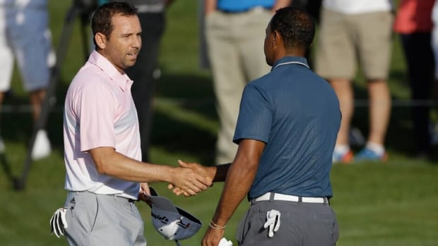 In this photo from May 12, Sergio Garcia, left, shakes hands with Tiger Woods at the end of the third round of The Players championship at TPC Sawgrass.