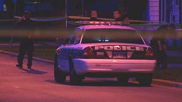 Police investigate after the shooting on Alfred Avenue.