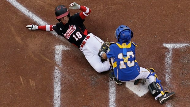 Ottawa, Canada's Angus Adams, left, steals home under the tag from Brno, Czech Republic's Daniel Stoudek during the third inning of a game in International elimination play at the Little League World Series tournament on Saturday in South Williamsport, Pa. Canada won 4-3.