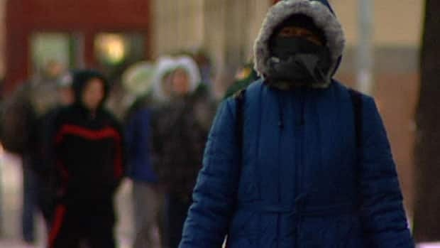 People pulled on parkas in Winnipeg on Tuesday, as temperatures dropped to -25 C.