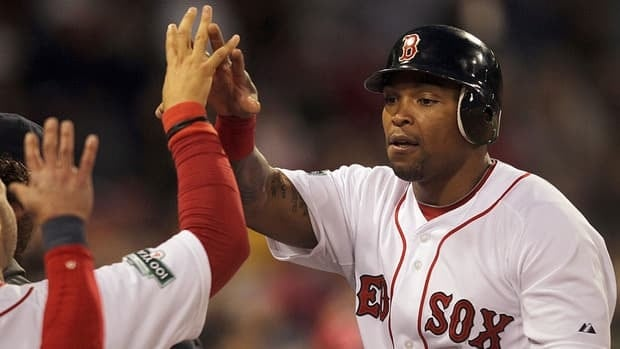 Marlon Byrd, seen here on April 30 as a member of the Boston Red Sox, has been suspended 50 games by Major League Baseball after testing positive for a banned substance.