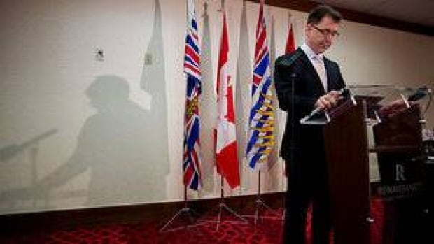 British Columbia NDP Leader Adrian Dix looks down at his notes while speaking to the media in Vancouver, B.C., on May 22, 2013.