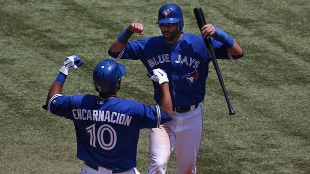 Edwin Encarnacion of the Toronto Blue Jays is congratulated by Jose Bautista after his two-run home run in the third inning.