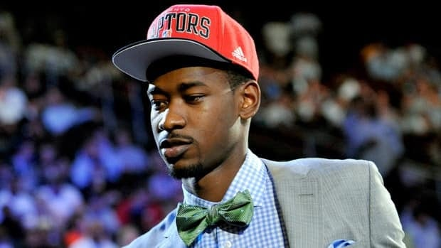 Washington's Terrence Ross walks to the stage as the No. 8 overall draft pick selected by the Toronto Raptors in the NBA basketball draft on Thursday.