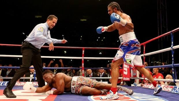 David Haye knocks out Dereck Chisora during their vacant WBO and WBA International Heavyweight Championship bout on July 14, 2012 in London, England.