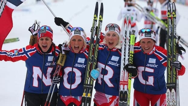 From left to right, Heidi Weng, Therese Johaug, Kristin Steira and Marit Bjoergen of Norway celebrate their relay win at the Nordic world ski championships on Thursday.