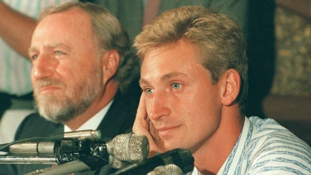 Oilers owner Peter Pocklington, left, was villified for selling the beloved Wayne Gretzky to the L.A. Kings.