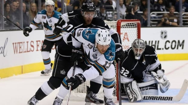 Raffi Torres hit Jarret Stoll late in the second period of the Kings' 2-0 victory over the Sharks on Tuesday.