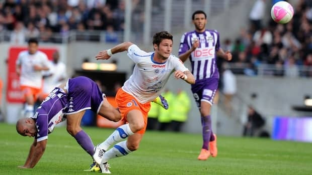 Toulouse's defender Aymen Abdennour, left, vies with Montpellier's forward Olivier Giroud on Friday.