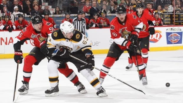 Sergei Gonchar and Bobby Butler of the Senators chase Brad Marchand (63) in a 5-3 home loss to the Bruins last Saturday.