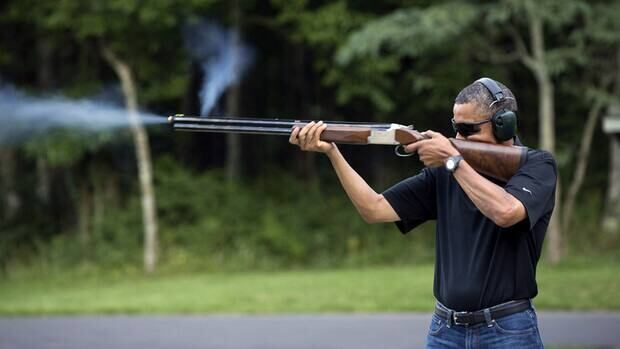 In this photo released by the White House, U.S. President Barack Obama shoots at clay targets on the firing range at Camp David, Md., on Aug. 4, 2012.