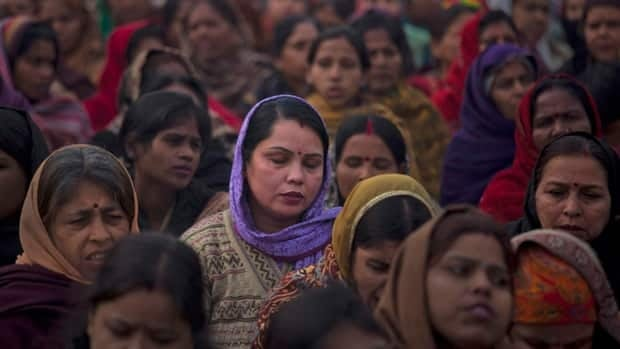 Indian women in New Delhi offer prayers for a 23-year-old gang rape victim. On Friday, the friend of the woman described briefly fighting off the men before they brutally attacked her.