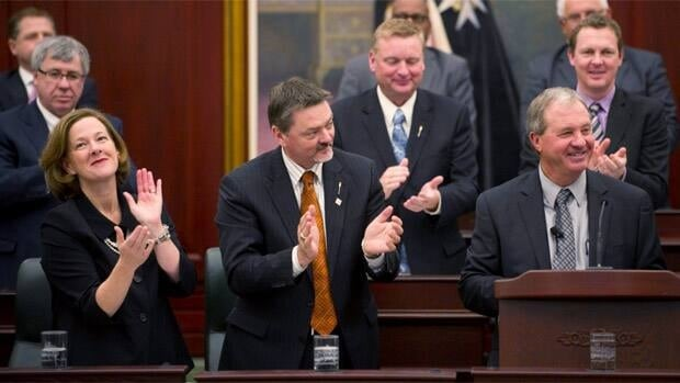 Alberta Premier Alison Redford and Deputy Premier Doug Horner applaud after Finance Minister Ron Liepert delivers his budget speech in Edmonton on Thursday.