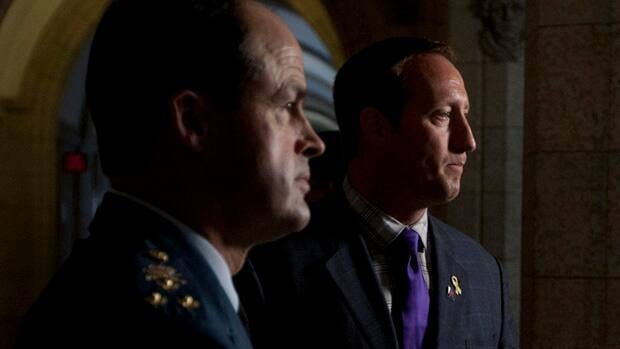 Chief of Defence Staff Tom Lawson, left, and Defence Minister Peter MacKay, seen here announcing Lawson's appointment last August, are under pressure to trim defence budgets now that Canada's mission in Afghanistan is over.