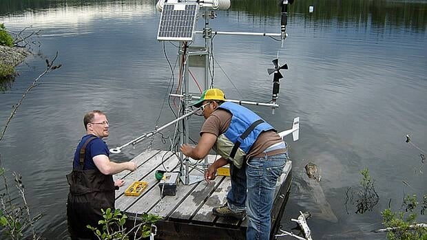 Scientists set up a raft with one of a series of micro-meterological stations on a lake in the Experimental Lakes Area in this undated photo. University researchers say important work will be lost if Ottawa doesn't reverse a decision to end the facility's funding.