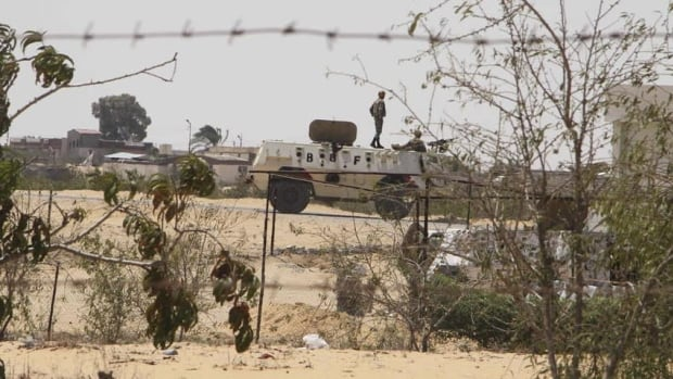 Egyptian border guards patrol near the border with Israel in Rafah, Egypt, in August. After decades of neglect and with the collapse of government authority the past 18 months, Egypt's Sinai Peninsula has become fertile ground for Islamic militant groups.