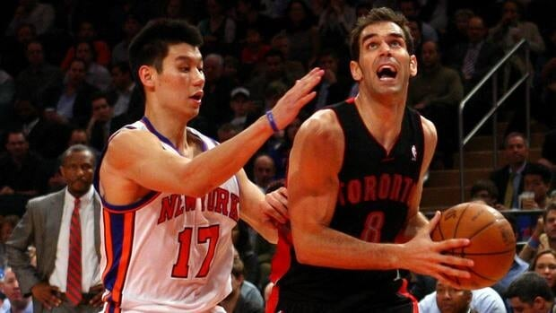 Jose Calderon of the Toronto Raptors drives in the first half against Jeremy Lin of the New York Knicks at Madison Square Garden on Tuesday in New York.