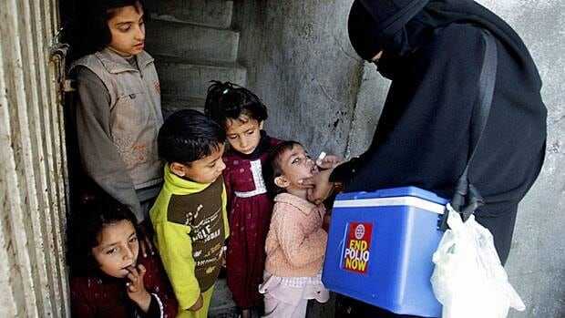 A Pakistani health worker gives polio vaccine to a child in Lahore in January 2013. Following deadly attacks on health workers in December, Pakistan resumed its anti-polio drive in certain neighbourhoods for a short period, under police protection. It also called for children ages 5 and under who are travelling out of the country to be vaccinated at airports, after traces of the Pakistani virus were discovered in Egypt.