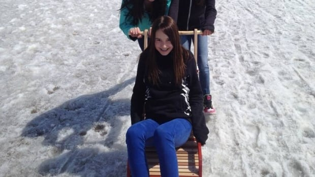 Students at Ecole St. Paul learning how to kicksled.