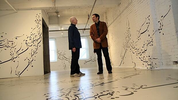 Barbara Luderowski and Michael Olijnyk stand in Written Room, one of the latest installations at the Mattress Factory. The art museum is an economic driver in Pittsburgh. Local arts advocates say it could work here too.