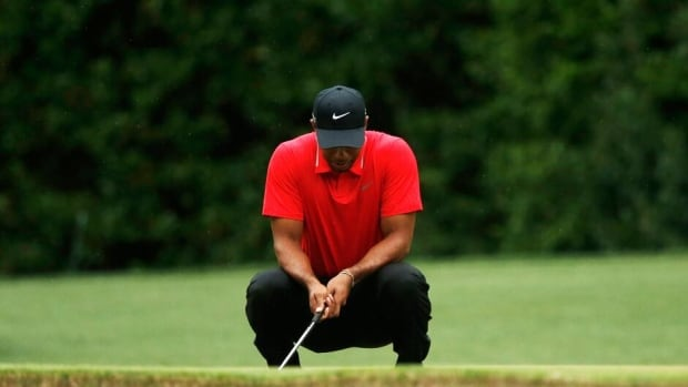 Tiger Woods reacts to missing a birdie putt on the fourth green during final round play Sunday at the Masters.