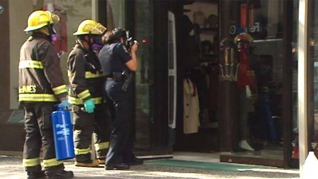 Police and fire firefighters attend at one of the Vancouver fur shops attacked this week.