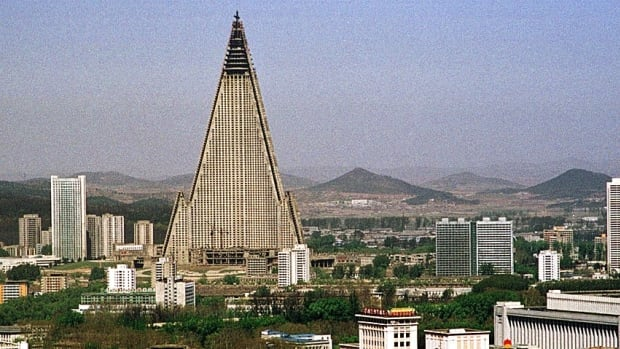 A 2002 photo shows the 105-storey Ryugyong Hotel in Pyongyang, North Korea. The building has been under construction since the 1980s, but officials say it could partially open by next year.