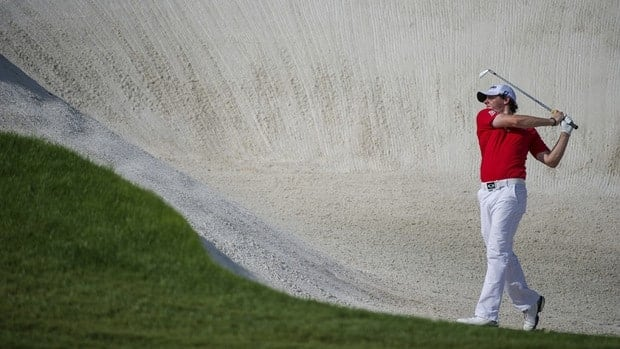 Rory McIlroy of Northern Ireland plays a bunker shot on the 8th hole during the final round of the DP World Golf Championship in Dubai, United Arab Emirates on Sunday.