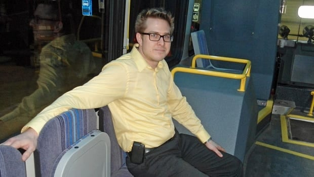 Jon Hendel, planning and marketing analyst for Thunder Bay Transit, tries out a new theatre-style bus seat. When the seats are empty, they fold up along the inside wall of the bus.