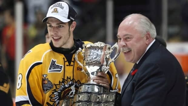 CHL president David Branch, shown here presenting the Memorial Cup to Shawinigan Cataractes captain Michael Bournival this past May, is questioning who is behind the CHLPA.