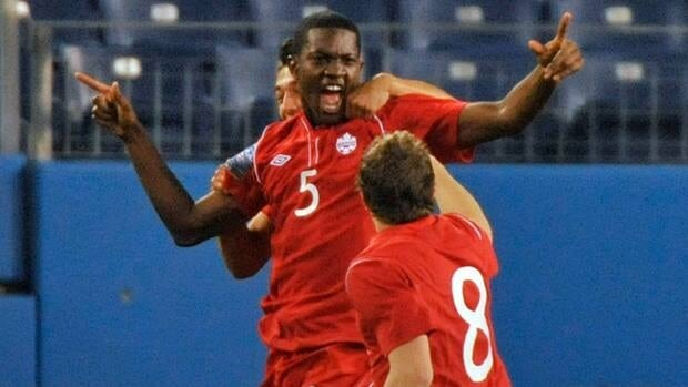 Canada's Doneil Henry (5) is greeted by teammate Samuel Piette after scoring against the U.S. on Saturday. The Canadians stunned the U.S., in the CONCACAF men's under-23 Olympic qualifying match.