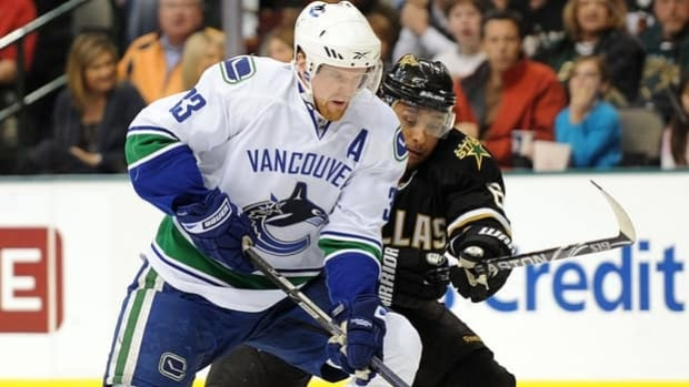Henrik Sedin (33) and the Canucks welcome rare visitors in Trevor Daley and the Stars to Rogers Arena on Friday night.
