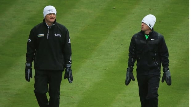 It was a cold day for Rory McIlroy, left, and Paul Lawrie during the second round of the BMW PGA Championship in Virginia Water, England. They're among several prominent golfers who've been frozen out of the tournament after missing the cut.