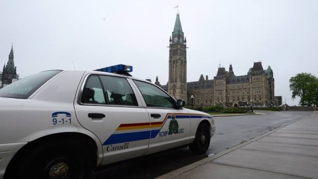 An RCMP cruiser sits parked on Parliament Hill in Ottawa on May 29, 2013. Senators are recommending the force change its code of conduct regarding harassment.