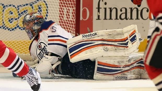 Nikolai Khabibulin was beaten on the last shot Sunday, as Edmonton settled for a point against the NHL-best Blackhawks in Chicago.