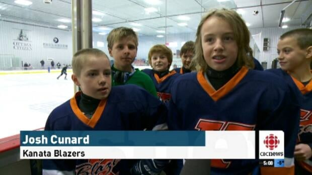 Surrounded by his teammates, Kanata Blazer player Josh Cunard (second from right) is eager for the puck to drop at the Bell Capital Cup.