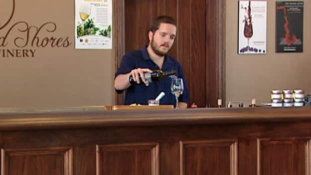 Sprucewood Shores' Jake Mitchell says his winery will soon have two wines on the shelf and now has two new tanks to keep up with demand.