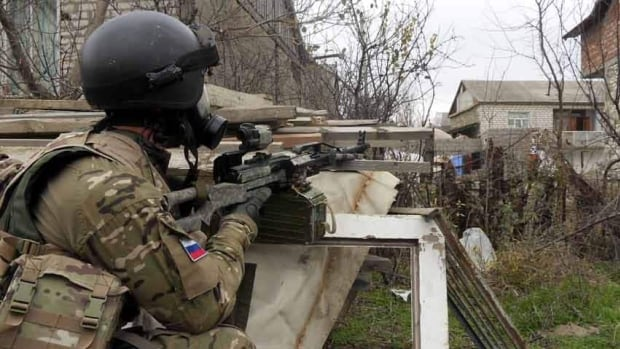 A Russian Special Forces officer aims his weapon during a 2010 raid in a village in Dagestan -- part of the war-torn region in southern Russia where some say alleged Boston Marathon bomber Tamerlan Tsarnaev embraced militant Islam.
