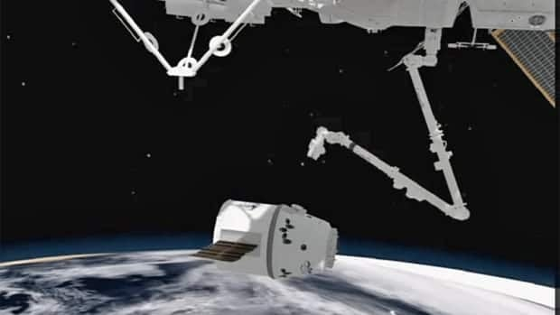 Computer animation shows the Canadarm2 reaching out to grab the SpaceX Dragon capsule and dock it at the International Space Station, which is what it will have to do on Friday.